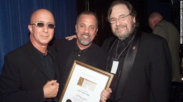 Music producer and innovator <a href='http://www.cnn.com/2013/03/30/showbiz/obit-phil-ramone/index.html'>Phil Ramone</a>, right, with Paul Shaffer, left, and Billy Joel at the Song Writers Hall of Fame Awards in New York in 2001. Ramone died March 30 at the age of 72.
