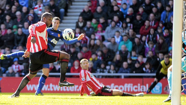 Sunderland's Titus Bramble (left) deflects Robin van Persie's shot towards goal at the Stadium of Light.