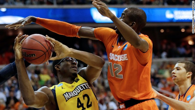 Chris Otule of Marquette draws contact against Baye Moussa Keita of Syracuse on March 30.
