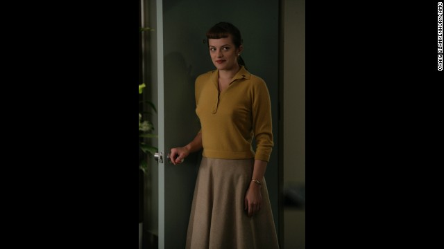 Elisabeth Moss plays Peggy Olson, who starts the show as a secretary.