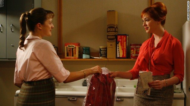 Peggy returns a dress to Joan Holloway, played by Christina Hendricks. In season 1, Joan is the agency's office manager.