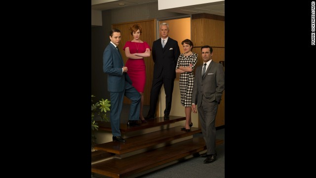 The cast poses in the Sterling Cooper Office.