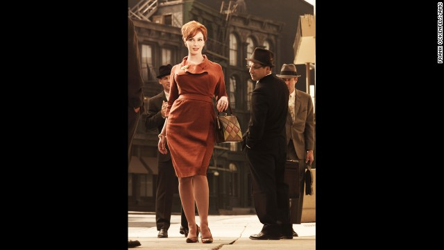 Joan Holloway attracts male attention wearing a flattering wrap dress in season 3.
