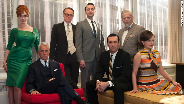 From left to right, Joan Harris, Roger Sterling, Lane Pryce, Pete Campbell, Don Draper, Bertram Cooper (Robert Morse) and Peggy Olson pose together at the office.