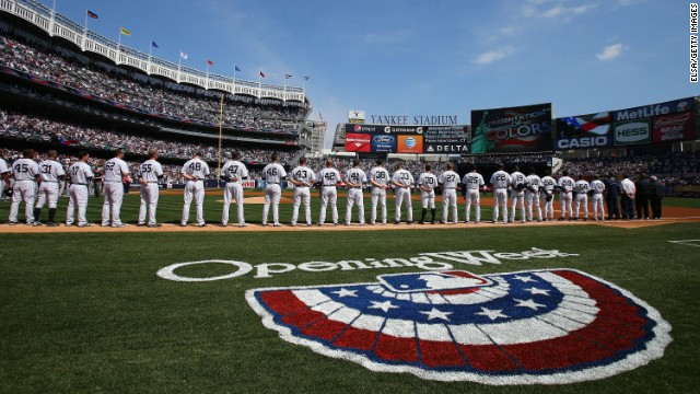 Members of the New York Yankees and the Boston Red Sox line up for player introductions on April 1 at Yankee Stadium in New York. The Yankees fell to the Red Sox 8-2.