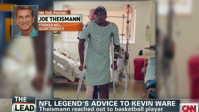Former Redskins quarterback Joe Theismann gives advice to Kevin Ware