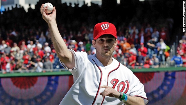 Former Staff Sgt. Clint Romesha, a Medal of Honor recipient, throws the ceremonial first pitch before the opening day game between the Nationals and the Marlins.