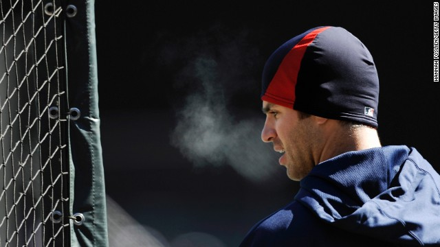 Joe Mauer of the Minnesota Twins looks on during batting practice before taking on the Detroit Tigers.