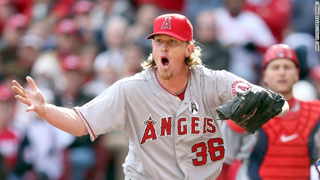 Angels pitcher Jered Weaver reacts after Shin-Soo Choo of the Reds was called safe at home plate.