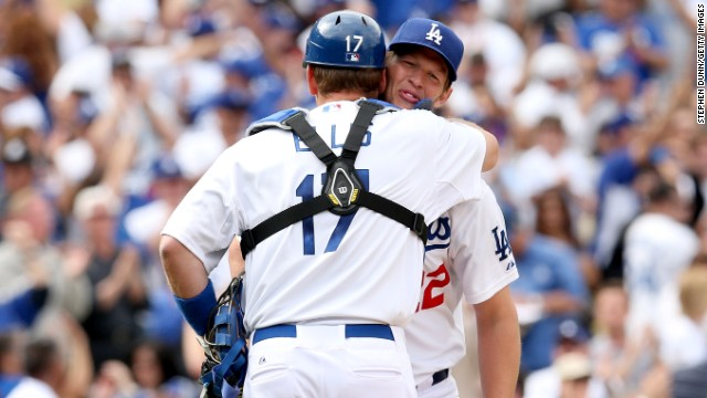 Pitcher Clayton Kershaw of the Los Angeles Dodgers is hugged by catcher A.J. Ellis after getting the final out of his complete game shutout against the San Francisco Giants on April 1 in Los Angeles. The Dodgers won 4-0.