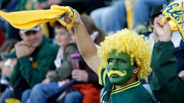 An Oakland fan cheers during a pregame ceremony April 1 at O.co Coliseum.