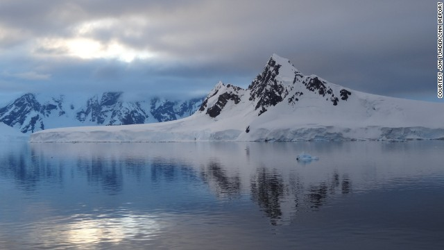 "Jon Tjader captured this photo as the <a href='http://ireport.cnn.com/docs/DOC-910492'>sun set </a>in Antarctica. ""I have been to over 60 different countries, and Antarctica hands down takes the cake as the most spectacular landscape on the planet,"" he said."