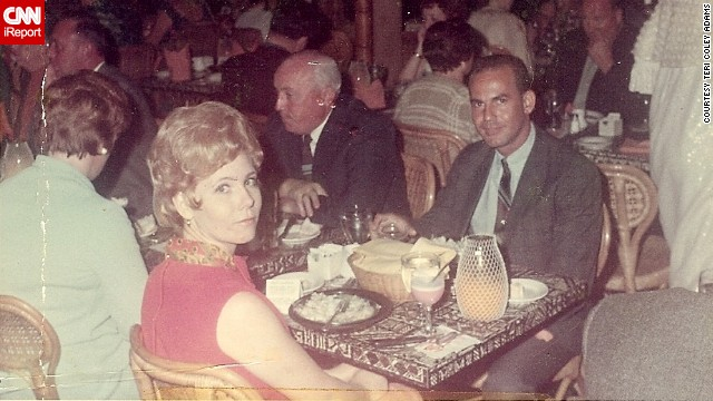 "<a href='http://ireport.cnn.com/docs/DOC-948004'>Teri Coley Adams' parents</a> enjoy an evening in Oahu, Hawaii, in 1969. Her dad is wearing a thin striped tie and a sports jacket. Her mom has on a red linen dress with a matching satin red peacock scarf. ""As I recall, the dress was pretty short, well above Mom's knees, but she had the legs for it,"" Adams says."