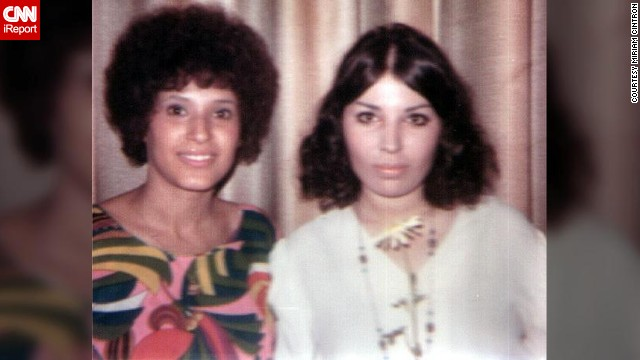 "<a href='http://ireport.cnn.com/docs/DOC-947498'>Miriam Cintron</a>, right, used an iron and an ironing board to straighten her hair in 1968. ""I preferred a more hippie look, but as I said, a clean hippie, not a shoeless one,"" she says."