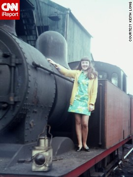 "Keith Long took this picture of his wife in 1969 on the running board of a steam engine in England. ""Sixties fashion was a changing decade -- very dated in the early part and trendy and totally different at the end,"" Long says."