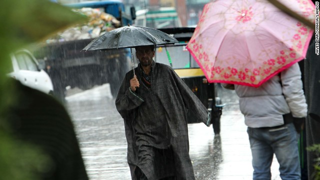 Heavy rains bring out umbrellas in force on the streets of Srinagar, India, on Wednesday, April 3.