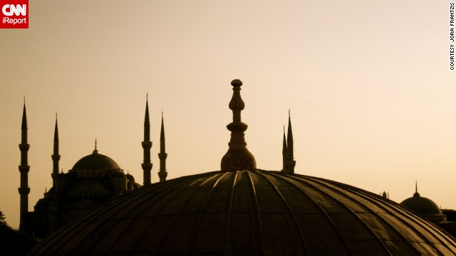 The Sultan Ahmed Mosque -- commonly called the &quot;blue mosque&quot; because of its vibrant blue tiles -- is silhouetted against the evening sky. See more photos from around Istanbul on CNN iReport.