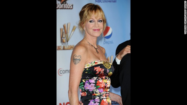 "Melanie Griffith showed off her ""Antonio"" tattoo, honoring husband Antonio Banderas, at the 2011 American Latino Media Arts Awards. But with the actress filing for divorce this year, <a href='http://www.tmz.com/2014/06/23/melanie-griffith-antonio-banderas-tattoo-divorce-photoshop/' target='_blank'>it looks like the tattoo outlasted the marriage.</a>"