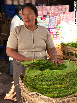 Chewing betel nut is a national pastime. Small street stalls, like this one in Mandalay, selling the palm-sized green leaves are everywhere. The leaves are filled with betel nut, spices and sometimes a pinch of tobacco, then folded and popped in the mouth and chewed.