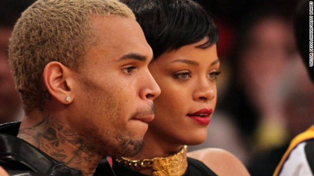 "Chris Brown, shown here with Rihanna in December 2012, took heat when he debuted a <a href='http://marquee.blogs.cnn.com/2012/09/11/chris-browns-rep-on-his-tatoo-its-not-rihanna/' target='_blank'>tattoo on his neck</a> that some people thought resembled a battered woman's face. ""His tattoo is a sugar skull (associated with the Mexican celebration of the Day of the Dead) and a MAC cosmetics design he saw,"" his rep said in a statement. ""It is not Rihanna or an abused woman as erroneously reported."""