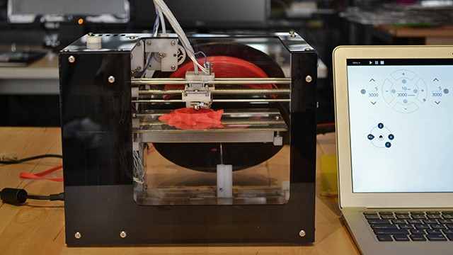 The $300 MakiBox A6 HT 3-D printer prints the start of an octopus figure in the Makible offices.