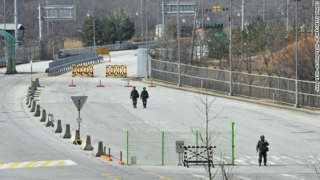 South Korean soldiers walk down the empty road after trucks were denied access to the Kaesong joint industrial park in North Korea in April as tensions flared.