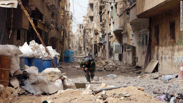 A Syrian rebel runs for cover in Deir ez-Zor on April 2.