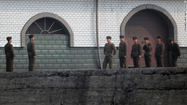 North Korean soldiers gather by the docks in Sinuiju, near the Chinese border, on Thursday, April 4.