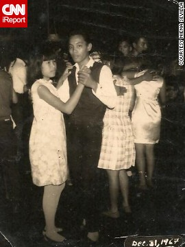 "<a href='http://ireport.cnn.com/docs/DOC-948028'>Niena Sevilla's father</a> attended a New Year's Eve party in the Philippines in 1968. Her dad, 18 years old at the time, danced with one of the partygoers he met at the event. ""Women of the '60's were so natural,"" Sevilla says."