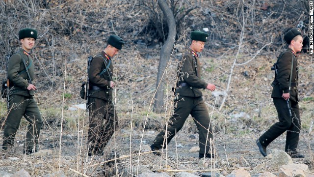 North Korean soldiers patrol along the Yalu River in Sinuiju across the border from the Chinese city of Dandong on April 4.