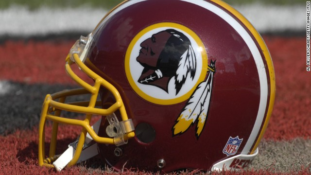 A Washington Redskins helmet sits on the field.