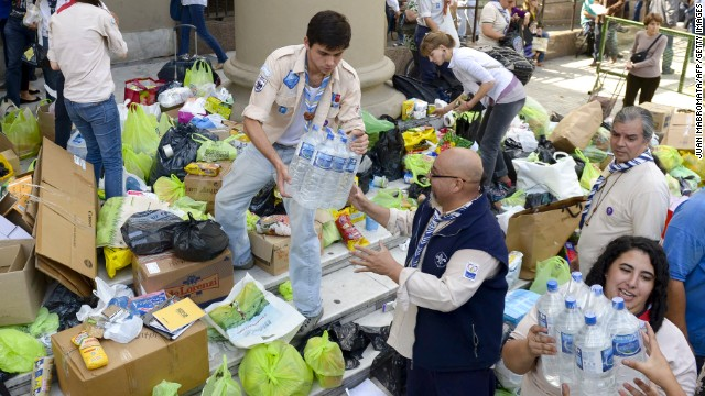 Volunteers load donated supplies in front of the Metropolitan Cathedral in Buenos Aires on Thursday, April 4. A storm has claimed dozens of lives in the capital and nearby La Plata, officials said.