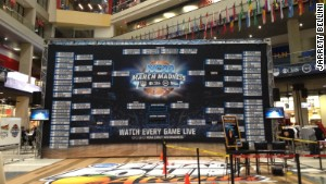 A giant March Madness bracket lives in the CNN Center atrium to remind visitors that they\'ve absolutely lost their office pool.