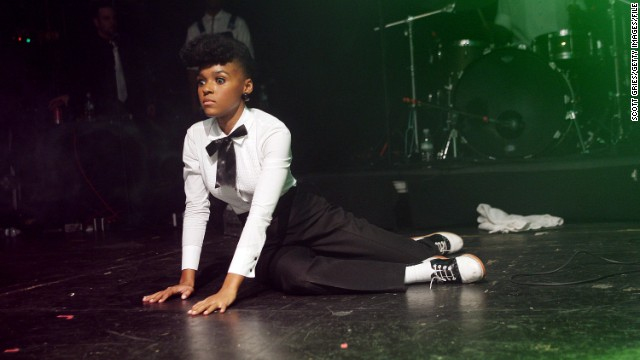 "Singer Janelle Monáe's Twitter bio, ""I feel myself truly becoming the fearless person I have dreamt of being,"" embodies what it means to be a tomboy in spirit. The story behind her look: During a <a href='http://colorlines.com/archives/2012/11/janelle_monae_talks_about_being_a_former_maid_and_why_she_still_wears_a_uniform.html' target='_blank'>November awards ceremony</a>, Monáe said she sticks to her ""uniform"" of black and white jacket and pants to honor her mother and father, who wore uniforms as a janitor and trash collector. ""This is a reminder that I have work to do, I have people to uplift, I have people to inspire,"" she said."