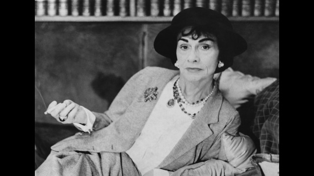 While French fashion designer <a href='http://www.biography.com/people/coco-chanel-9244165' target='_blank'>Coco Chanel</a>'s trademark suit and little black dress are undeniably feminine, she incorporated elements of menswear that made them comfortable and easy to wear, liberating women from the confining garments of the early 20th century. She never married but dated many, including the duke of Westminister, whose wedding proposal she reportedly turned down. She is also said to have derived inspiration from her dates' clothes, supposedly taking their blazers and tailoring them to fit her.