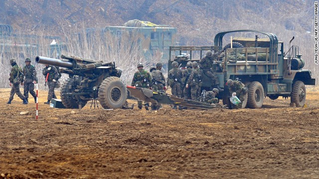 South Korean soldiers man a cannon at a military training field in Paju on April 5.