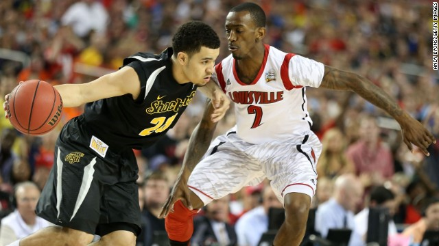 Fred VanVleet of Wichita State drives with the ball against Russ Smith of Louisville.