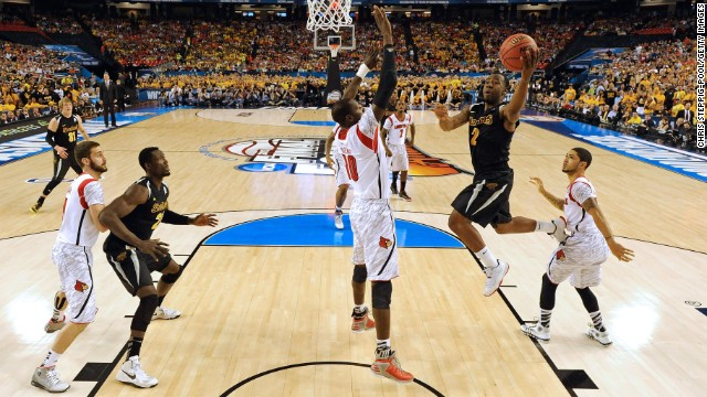 Malcolm Armstead of Wichita State, second from right, drives for a shot attempt against Gorgui Dieng, third from right, Louisville.