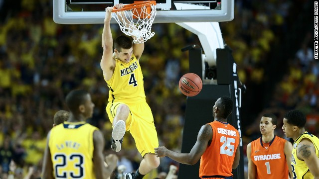 Mitch McGary of Michigan dunks against Rakeem Christmas of Syracuse.