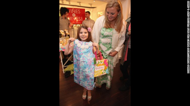 Charlotte Mendelson, left, shows off a new Lilly Pulitzer dress given to her by Camilla Webster during the 2012 Shop & Share.