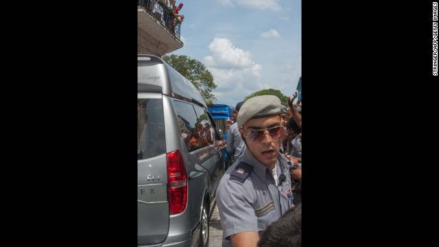 Cuban police block people from reaching the couple on Friday.
