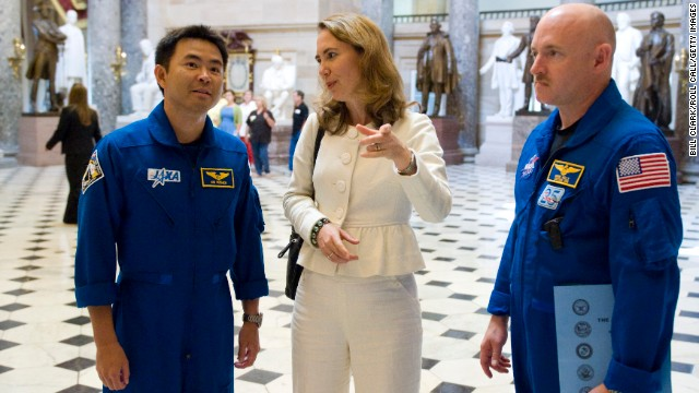 Giffords gives a tour of Statuary Hall in the Capitol to Shuttle Discovery STS-124 astronauts Akihiko Hoshide of Japan, left, and her husband, Cmdr. Mark Kelly, on July 17, 2008.