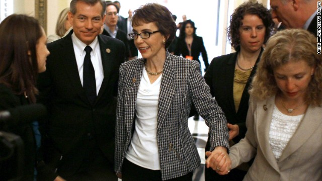 After resigning from Congress, Giffords is escorted down the hall by Rep. Debbie Wasserman Schultz of Florida on January 25, 2012. Giffords left office to focus on her recovery.