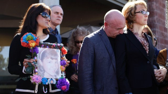 Giffords and Kelly attend a news conference on March 6 outside the Safeway grocery store in Tuscon. At the event they urged Congress to provide stricter gun control in the United States. At left, Roxanna Green holds a photo of her daughter, Christina Taylor Green, who was killed in the 2011 shooting.