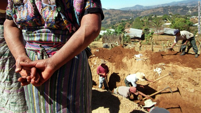Archeologists in March 2002 exhumed remains of victims from Guatemala's 1982 civil war massacre in the town of Xiquin Senai.