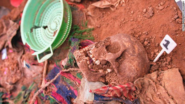 The trial offers a fascinating look in real time at how a nation, whose leaders are accused of genocide, is choosing to face its own demons. Following the 2002 exhumation of victims' remains in Xiquin Senai, ceremonies were held to properly bury the dead.