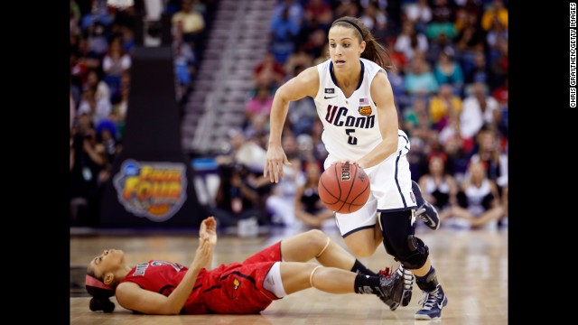 Caroline Doty of the Connecticut Huskies commits a flagrant foul against Bria Smith of the Louisville Cardinals in the first half of the NCAA Women's Championship in New Orleans Arena on April 9.