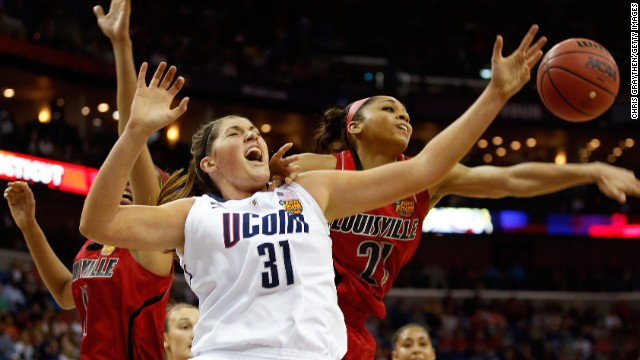Stefanie Dolson of the Connecticut Huskies and Bria Smith of the Louisville Cardinals go for a loose ball during the NCAA Women's Championship at New Orleans Arena on April 9.