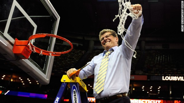 UCONN head coach Geno Auriemma cuts down the net after defeating the Louisville Cardinals on April 9.