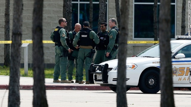 Harris County sheriff's officers seal off the campus after at least 14 people were injured in a stabbing incident at the CyFair campus of Lone Star College in Cypress, Texas, on Tuesday, April 9. The community college in northwest Houston was on lockdown and police detained student Dylan Quick, 20.